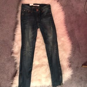 Grace distressed jeans with zippers on the side